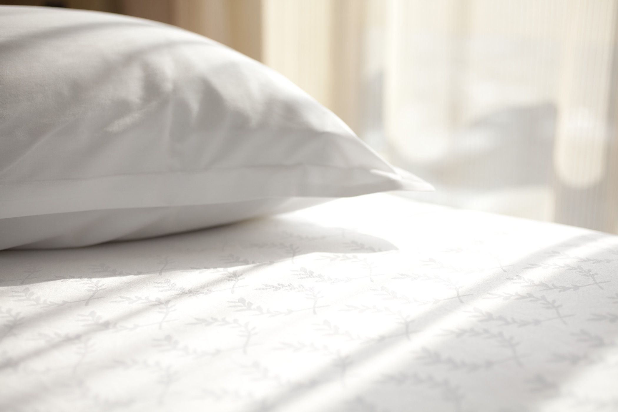 Crisp white linen of a hotel bed and pillow